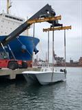 Invincible 35' Catamaran gets lifted from the RoRo into Australian waters - bow